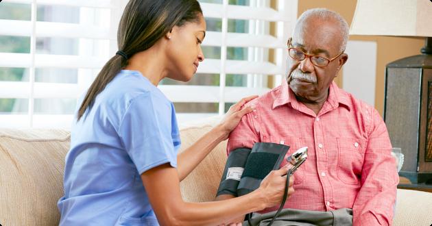 caregiver using a stethoscope