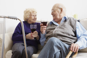 two elderly drinking