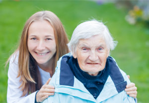 taking picture with her caregiver